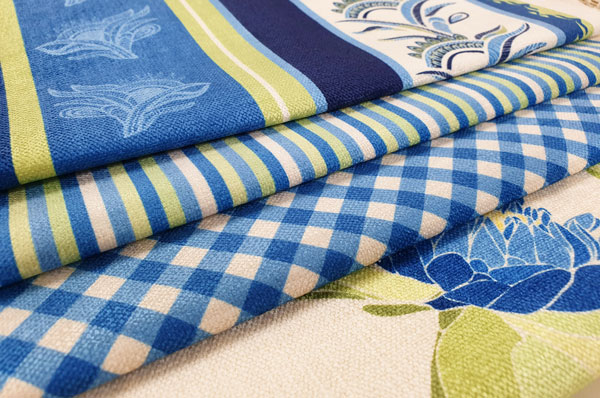 Blue printed fabric featuring stripes and gingham