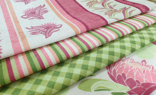 Pink and green printed fabric featuring stripes and gingham