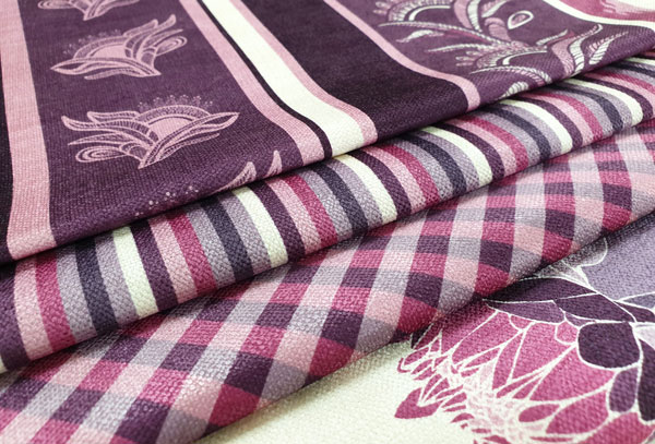 Purple printed fabric featuring stripes and gingham